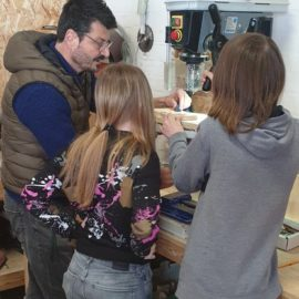Young people working with Angelo to use the power tools at Urban Workbench